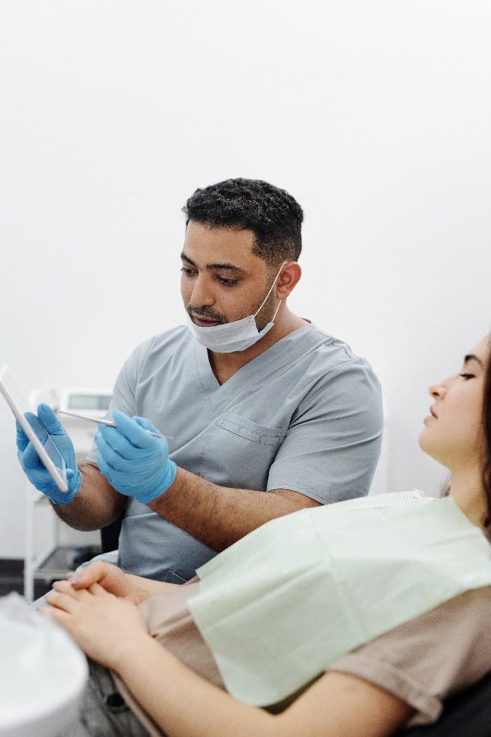 a general dentist in Cinnaminson, NJ, checks a patient