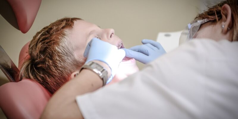 Dentist performing a root canal on a patient