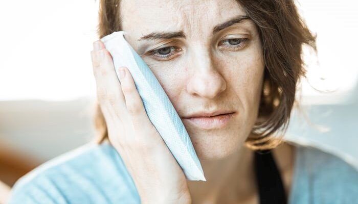 A woman suffering from a gum problem and in need of dental implants in Cinnaminson, NJ A woman suffering from a gum problem and in need of dental implants in Cinnaminson, NJ